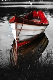 red boat black and white photography