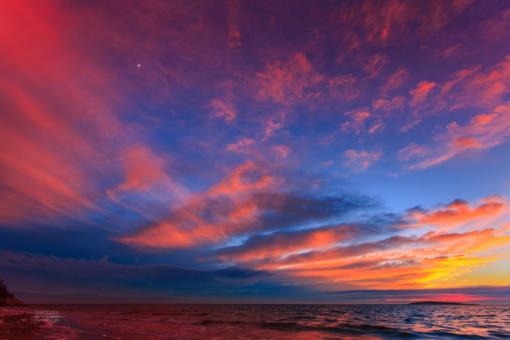 Clouds and moon colored by sunset over Indian Neck beach tonight in Wellfleet, Cape Cod. Photo by Dapixara https://dapixara.com