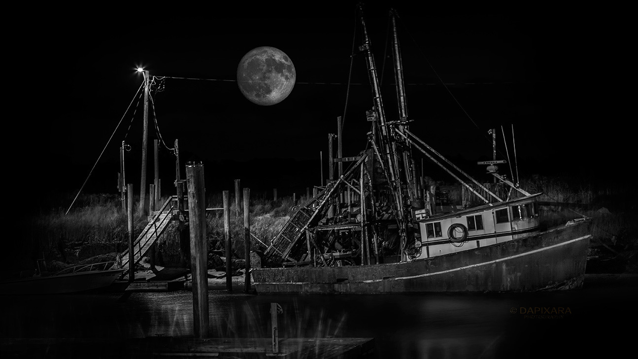 Black and white art fishing boat and full moon